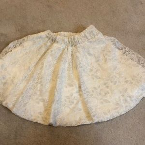 Brand new lace white skirt with shimmer